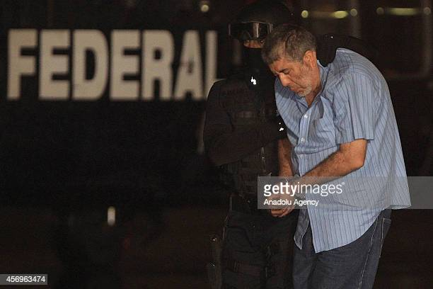 Alleged Juarez Cartel boss Vicente Carrillo Fuentes alias El Viceroy brother of the late Mexican drug lord Amado Carrillo is escorted to a helicopter...