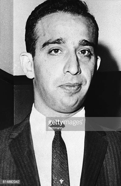 Alleged Mafia member Carmine The Snake Persico stands wearing a suit and tie