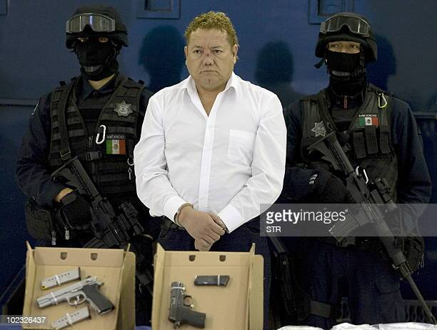 Alleged member of the drug cartel Beltran Leyva Francisco Jose Barreto aka El Contador is presented to the press at the Federal Police headquarters...