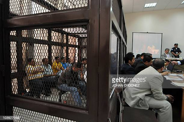 Alleged members of Mexican drug traffickers group Los Zetas await inside a security cell at the court in Guatemala City September 8 2010 during their...