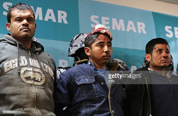 Alleged members of the Zetas group are presented in a press conference in Mexico City on December 4 following their arrest in Juarez Nuevo Leon State...