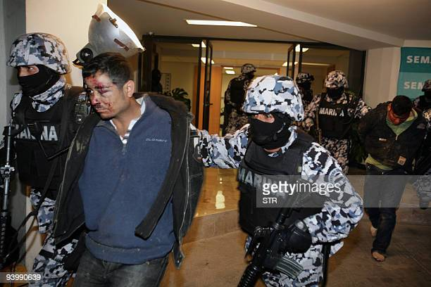 Alleged members of the Zetas group are taken to be presented in a press conference in Mexico City on December 4 following their arrest in Juarez...