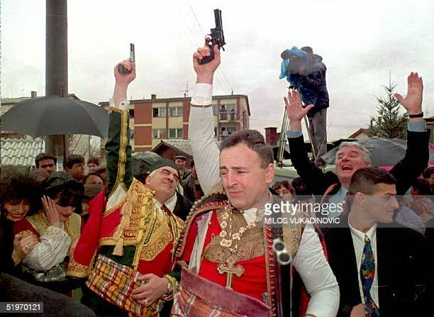 Alleged war criminal and Serb nationalist Zeljko 'Arkan' Raznatovic dressed in traditional Serbian dress fires a gun 19 February during his wedding...