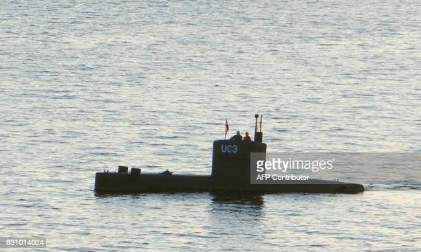 Allegedly Swedish journalist Kim Wall stands next to a man in the tower of the private submarine 'UC3 Nautilus' on August 10 2017 in Copenhagen...
