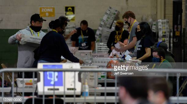 Allegheny County election employees organize ballots at the Allegheny County elections warehouse on November 7, 2020 in Pittsburgh, Pennsylvania....