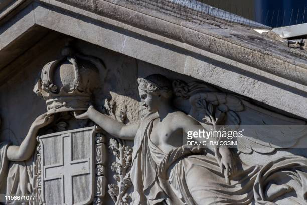 Allegorical statue depicting a Virtue or a civic activity by Giuseppe Argenti tympanum of one of the Neoclassical buildings that form the Barriera...