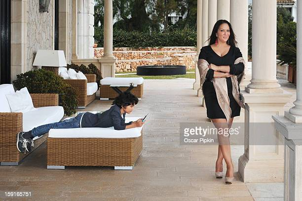 Allegra Curtis an her son Raphael pose for a picture during a portrait session at Hotel Maricel on December 13 2012 in Palma de Mallorca Spain