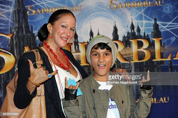Allegra Curtis and her son Raphael attend the Munich premiere of the film 'Saphirblau' at Mathaeser Filmpalast on August 12 2014 in Munich Germany
