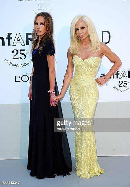 Allegra Versace and Designer Donatella Versace attend amfAR's Cinema Against AIDS Gala during the 64th Annual Cannes Film Festival at Hotel Du Cap on...