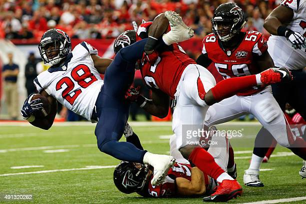 Allen Bradford of the Atlanta Falcons prevents Alfred Blue of the Houston Texans from scoring a touchdown in the second half at the Georgia Dome on...