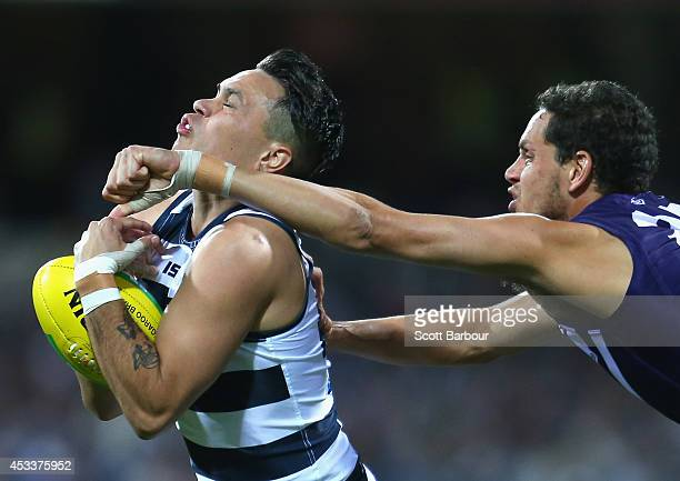 Allen Christensen of the Cats is tackled by Michael Johnson of the Dockers during the round 20 AFL match between the Geelong Cats and the Fremantle...