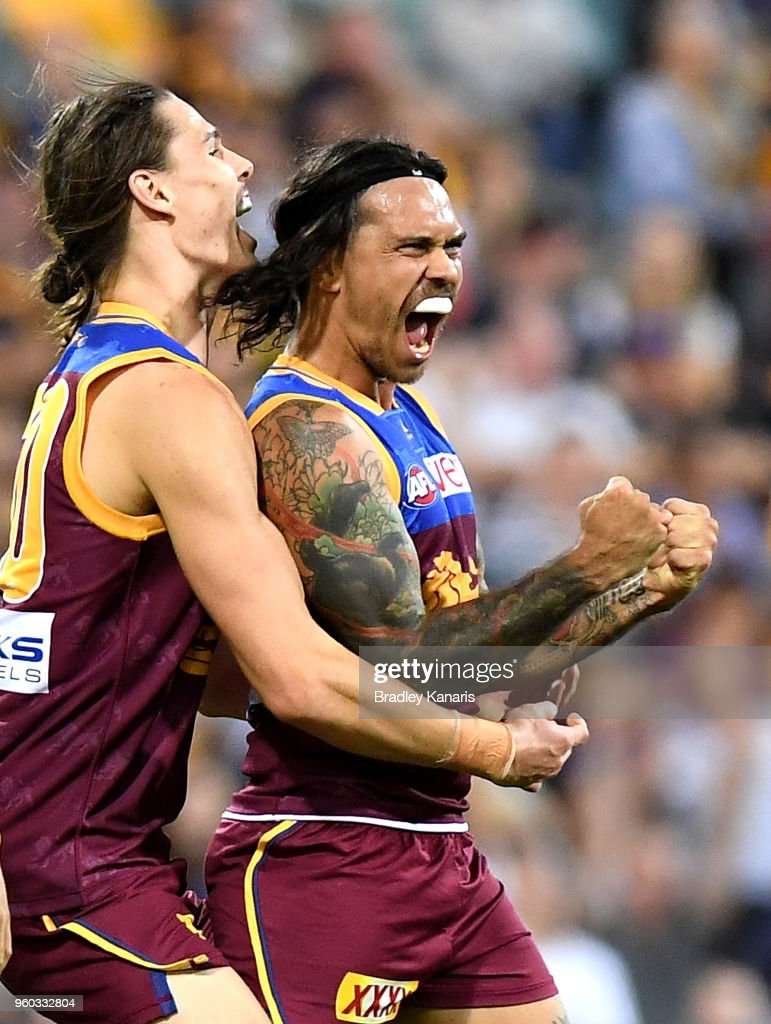 Allen Christensen of the Lions celebrates kicking a goal during the round nine AFL match between the Brisbane Lions and the Hawthorn Hawks at The Gabba on May 20, 2018 in Brisbane, Australia.
