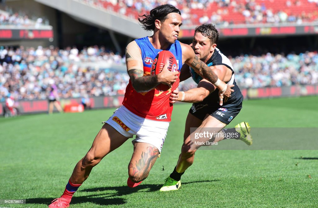 Allen Christensen of the Lions under pressure from Travis Boak captain of Port Adelaide during the round three AFL match between the Port Adelaide Power and the Brisbane Lions at Adelaide Oval on April 7, 2018 in Adelaide, Australia.