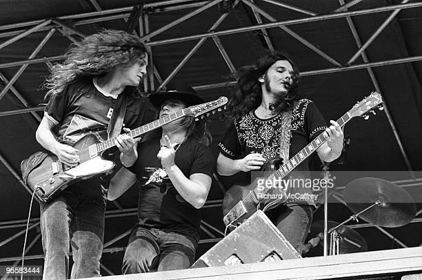R Allen Collins Ronnie Van Zant and Gary Rossington of Lynyrd Skynyrd perform live at The Oakland Coliseum in 1976 in Oakland California