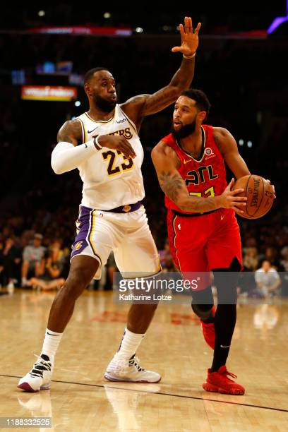 Allen Crabbe of the Atlanta Hawks drives around LeBron James of the Los Angeles Lakers during the first half of a game at Staples Center on November...