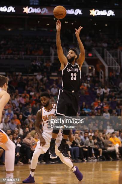 Allen Crabbe of the Brooklyn Nets attempts a shot against the Phoenix Suns during the second half of the NBA game at Talking Stick Resort Arena on...