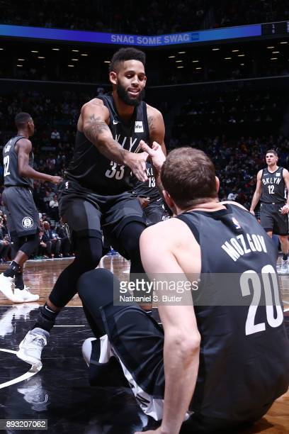 Allen Crabbe of the Brooklyn Nets displays great teamwork as they play against the New York Knicks on December 14 2017 at Barclays Center in Brooklyn...