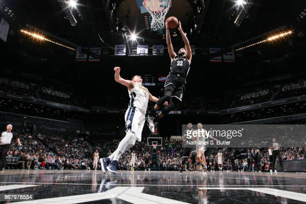 Allen Crabbe of the Brooklyn Nets drives to the basket against the Denver Nuggets on October 29, 2017 at Barclays Center in Brooklyn, New York. NOTE...
