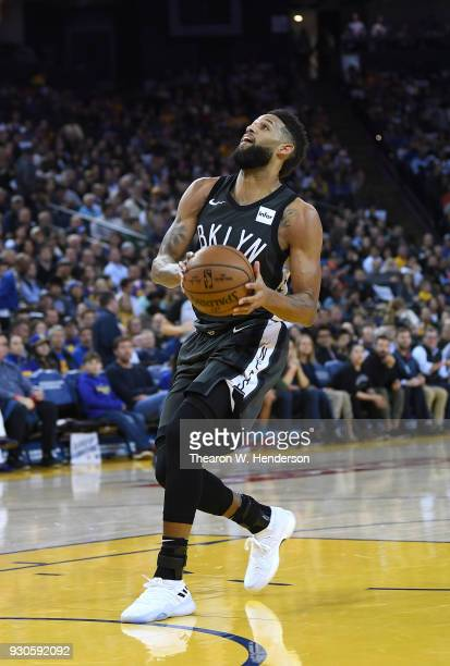 Allen Crabbe of the Brooklyn Nets drives to the basket against the Golden State Warriors during an NBA basketball game at ORACLE Arena on March 6...
