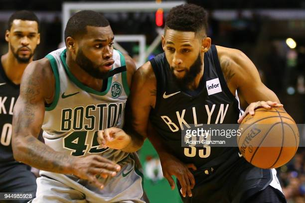 Allen Crabbe of the Brooklyn Nets drives to the basket past Kadeem Allen of the Boston Celtics during a game at TD Garden on April 11 2018 in Boston...