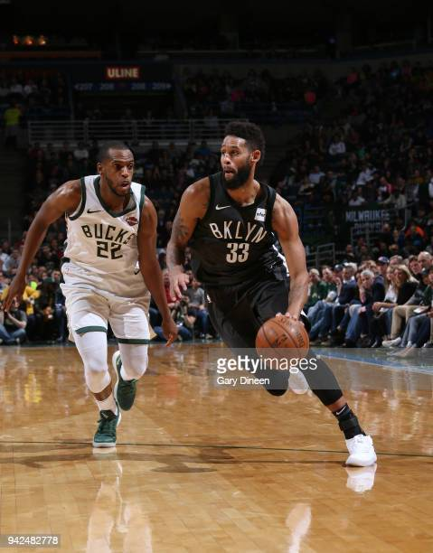 Allen Crabbe of the Brooklyn Nets handles the ball against Khris Middleton of the Milwaukee Bucks on April 5 2018 at the BMO Harris Bradley Center in...