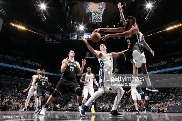 Allen Crabbe of the Brooklyn Nets passes the ball against the Denver Nuggets on October 29 2017 at Barclays Center in Brooklyn New York NOTE TO USER...