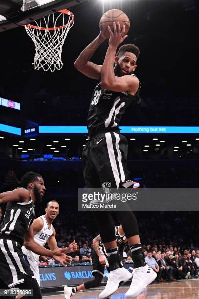 Allen Crabbe of the Brooklyn Nets rebounds the ball against Avery Bradley of the LA Clippers during the game at Barclays Center on February 12 2018...