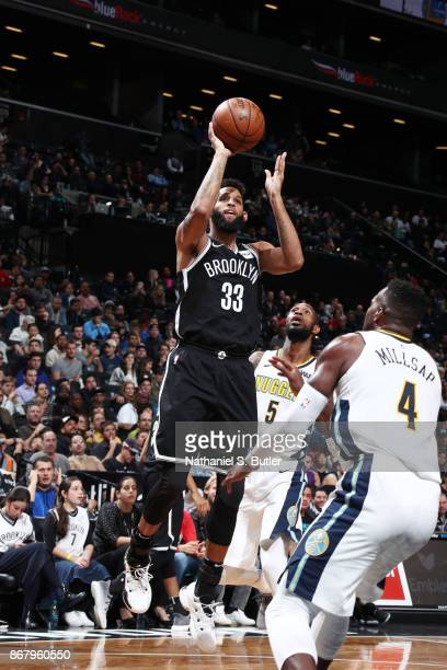 Allen Crabbe of the Brooklyn Nets shoots the ball against the Denver Nuggets on October 29 2017 at Barclays Center in Brooklyn New York NOTE TO USER...