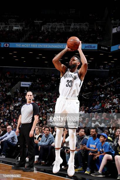 Allen Crabbe of the Brooklyn Nets shoots the ball against the New York Knicks during a preseason game on October 3 2018 at Barclays Center in...