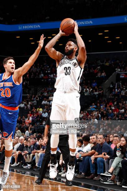 Allen Crabbe of the Brooklyn Nets shoots the ball against the New York Knicks during a preseason game on October 8 2017 at Barclays Center in...
