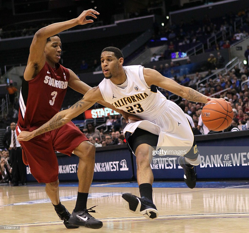Allen Crabbe #23 of the California Golden Bearsdrives against Anthony Brown #3 of the Stanford Cardinal during the quarterfinals of the Pac12 Men's Basketball Tournament at Staples Center on March 8, 2012 in Los Angeles, California. California won 77-71.