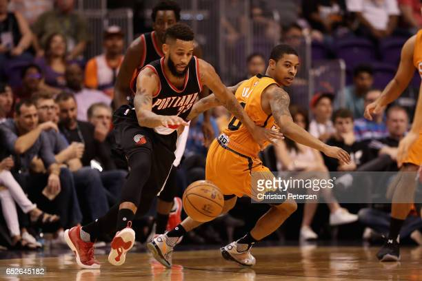 Allen Crabbe of the Portland Trail Blazers attempts to control the ball ahead of Tyler Ulis of the Phoenix Suns during the first half of the NBA game...