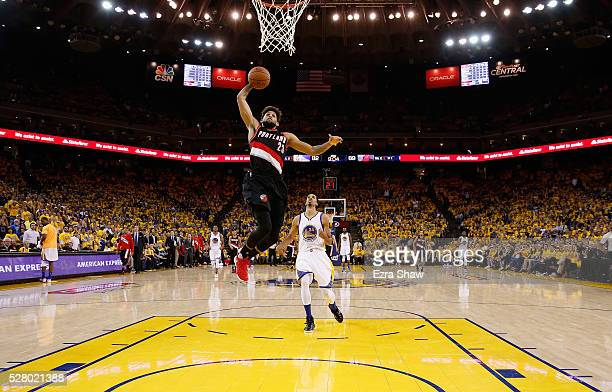 Allen Crabbe of the Portland Trail Blazers goes up for a dunk on Shaun Livingston of the Golden State Warriors during Game Two of the Western...