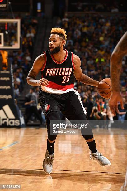 Allen Crabbe of the Portland Trail Blazers handles the ball against the Denver Nuggets on October 29 2016 at the Pepsi Center in Denver Colorado NOTE...