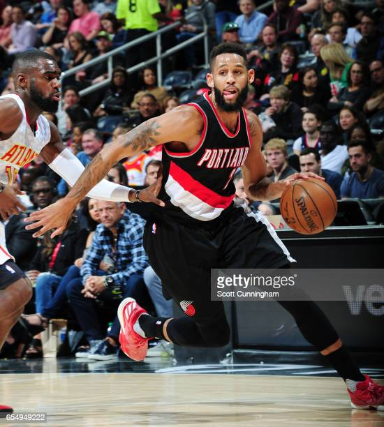 Allen Crabbe of the Portland Trail Blazers handles the ball against the Atlanta Hawks during the game on March 18 2017 at Philips Arena in Atlanta...