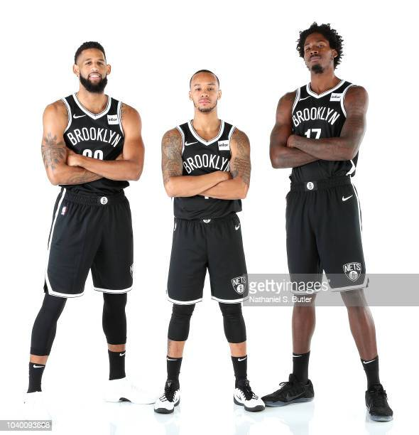 Allen Crabbe, Shabazz Napier and Ed Davis of the Brooklyn Nets poses for a portrait during Media Day on September 24, 2018 at HSS Training Center in...