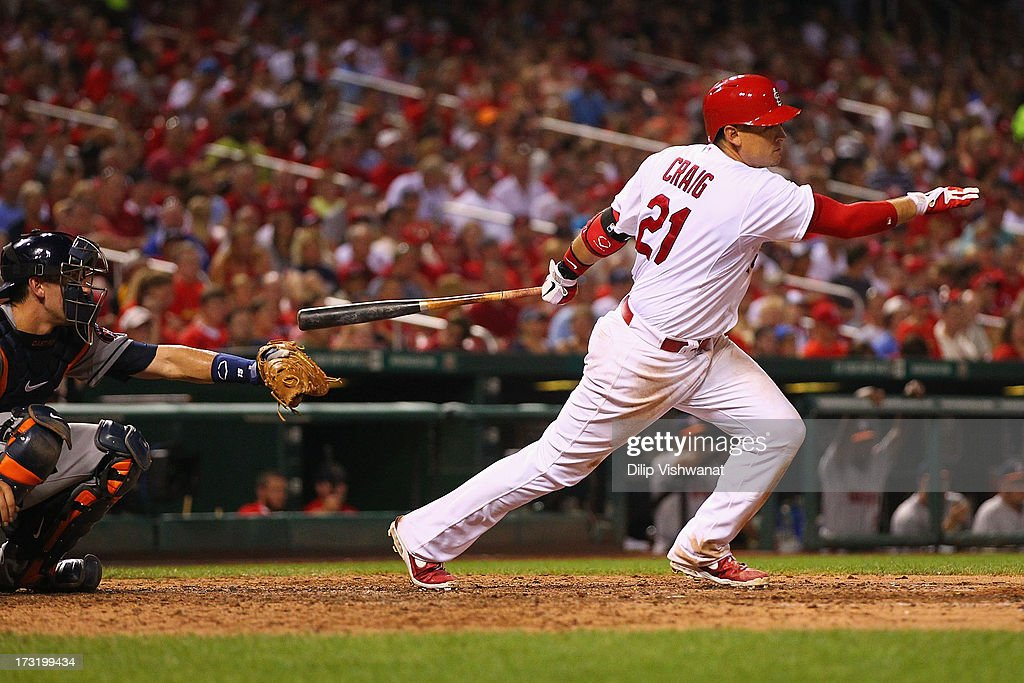 Allen Craig #21 of the St. Louis Cardinals hits an RBI single against the Houston Astros in the sixth inning at Busch Stadium on July 9, 2013 in St. Louis, Missouri. The Cardinals beat the Astros 9-5.