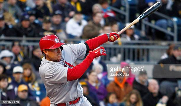 Allen Craig of the St Louis Cardinals hits into a sacrifice fly in the first inning against the Pittsburgh Pirates during the game at PNC Park April...