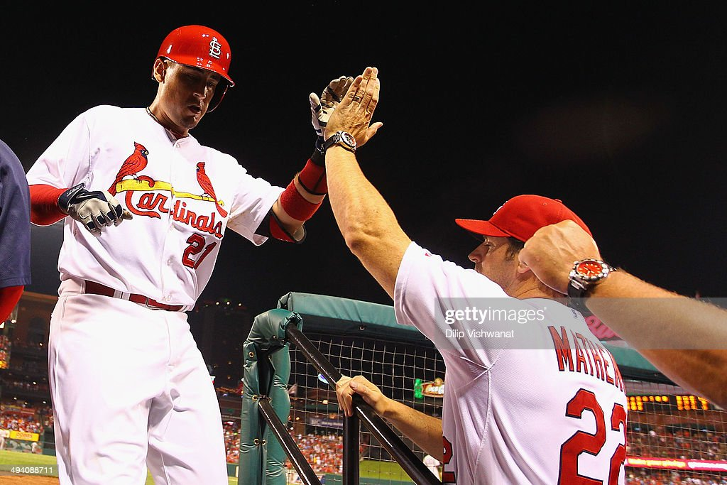 Allen Craig #21 of the St. Louis Cardinals is congratulated by manager Mike Matheny #22 of the St. Louis Cardinals after hitting a solo home run against the New York Yankees in the fifth inning at Busch Stadium on May 27, 2014 in St. Louis, Missouri. The Cardinals beat the Yankees 6-0.