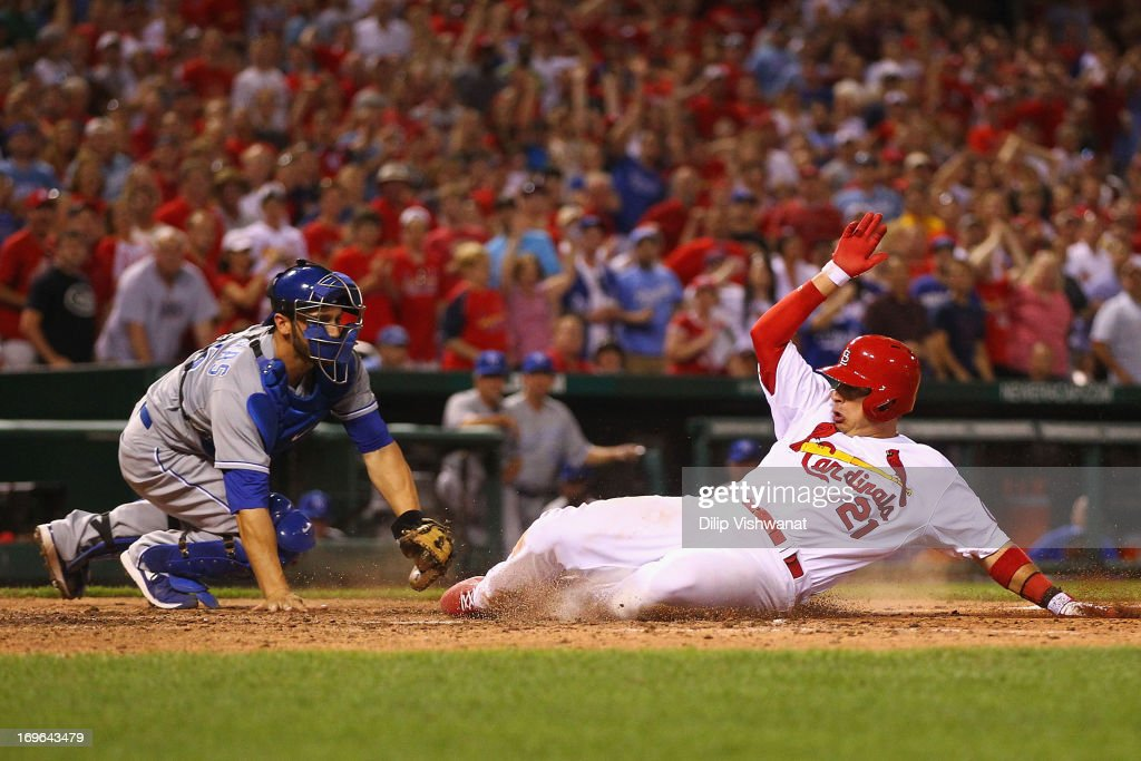 Allen Craig #21 of the St. Louis Cardinals scores the game-tying run against George Kottaras #26 of the Kansas City Royals in the eighth inning at Busch Stadium on May 29, 2013 in St. Louis, Missouri.