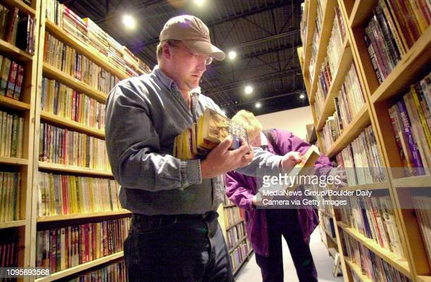 Allen Dillie coowner of The Book Worm stacks books in the western book section of their new location on 28th Street in Boulder while Claudia Lewis of...