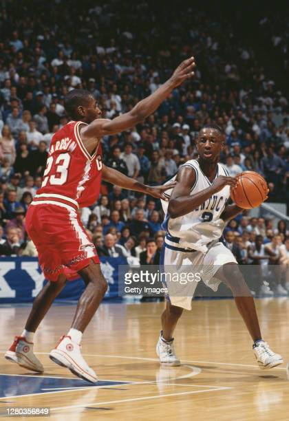 Allen Edwards, Forward for the University of Kentucky Wildcats dribbles the ball as Ray Harrison of the University of Georgia Bulldogs attempts to...