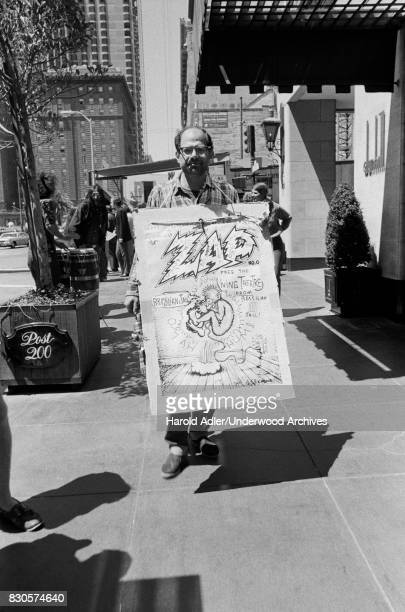 Allen Ginsberg carrying an R Crumb poster while demonstrating at Union Square against the arrests of Living Theater Company members in Brazil San...
