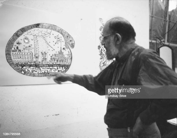 Allen Ginsberg points to a detail in a proof of his Untitled as he discusses that proof with Master Printer James Reid at Gemini G.E.L. As Ginsberg...