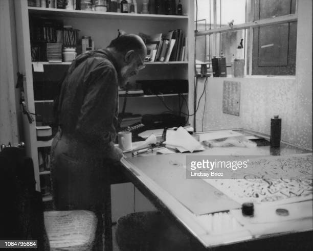 Allen Ginsberg stands at drafting table, his Untitled in an early stage to his right as he works in studio at Gemini G.E.L. Preparing his Buddhist...