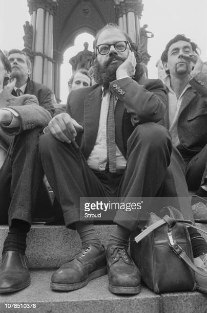 Allen Ginsberg with fellow poets and writers at the Albert Memorial in South Kensington, London, 11th June 1965. Behind him are : Anselm Hollo ,...