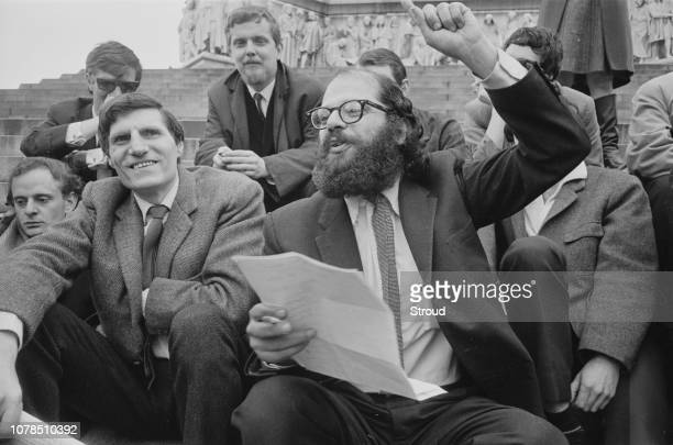 Allen Ginsberg with fellow poets and writers at the Albert Memorial in South Kensington London 11th June 1965 On the left are Adrian Mitchell and...