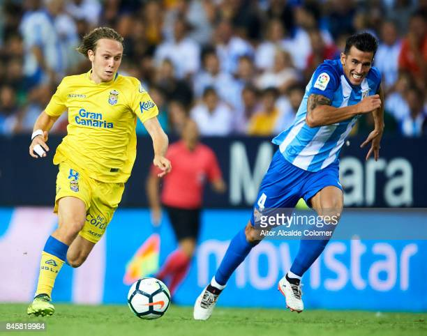 Allen Halilovic of Union Deportiva Las Palmas being followed by Luis Hernandez of Malaga CF during the La Liga match between Malaga and Las Palmas at...
