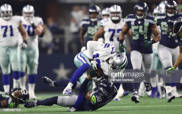 Allen Hurns of the Dallas Cowboys suffers a leg injury while tackled by Bradley McDougald of the Seattle Seahawks in the first quarter of the Wild...