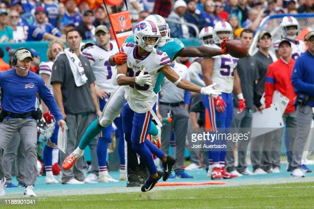 Allen Hurns of the Miami Dolphins is unable to make a one handed catch while being defended by Kevin Johnson of the Buffalo Bills during an NFL game...
